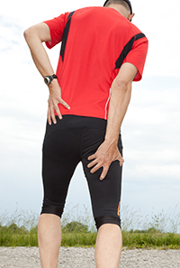 A runner holding his thigh