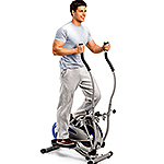 Handsome man exercising on a cross trainer machine