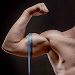 man measures his biceps with measuring tape